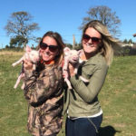 Veterinarians holding young piglets on GVE Livestock Day - Global Vet Experience
